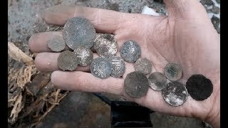 Work with metal detector - treasure metal detecting coins and artifacts for archeology -