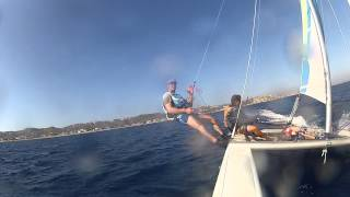 Erik on a catamaran in trapeze near the island Kos of Greece