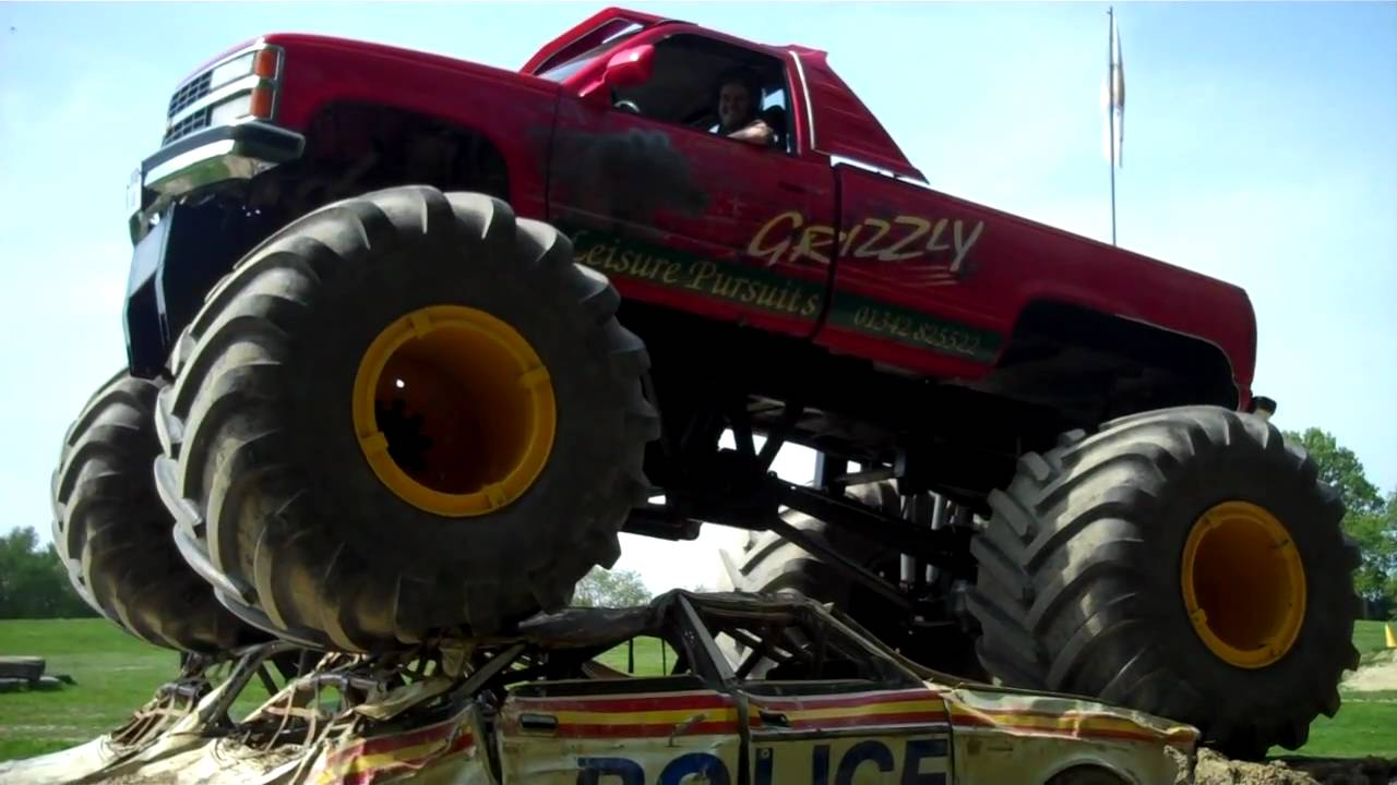 Monster Truck Grizzly Mounting The Police Cars Youtube
