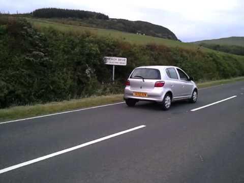 car rolling uphill at the electric brae