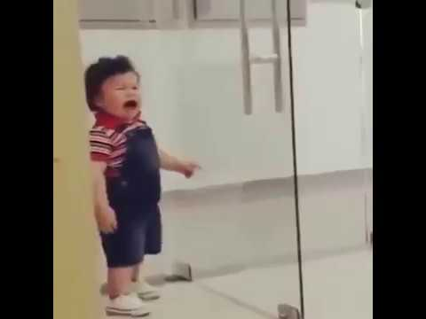 Kid Runs Into Glass Door And Cries Like A Siren Youtube