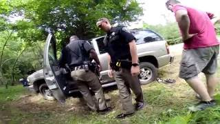 cops search abandoned vehicle