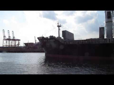Loading scrap metal onto a ship.