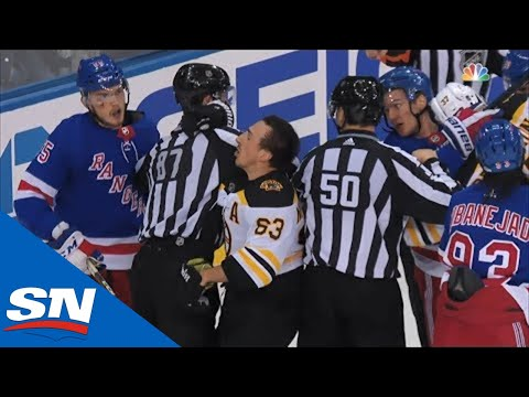 Brad Marchand Receives Helmet Popping Cross Check From Pavel Buchnevich