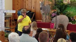 VBS Director Vicki Anderson Hands Out Certificates at Graduation 2019