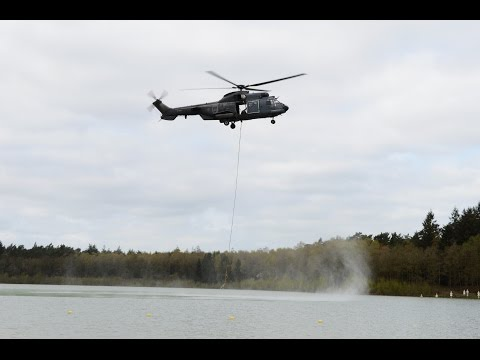 Fire bucket exercise with RNLAF AS532 Cougar at Heerderstrand