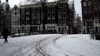 Snow in Amsterdam; people still ride their bicycles! :-)