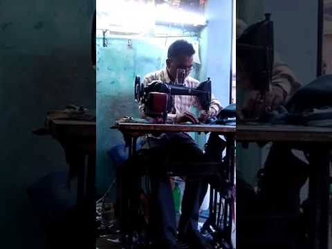 Indian tailor with vintage film music