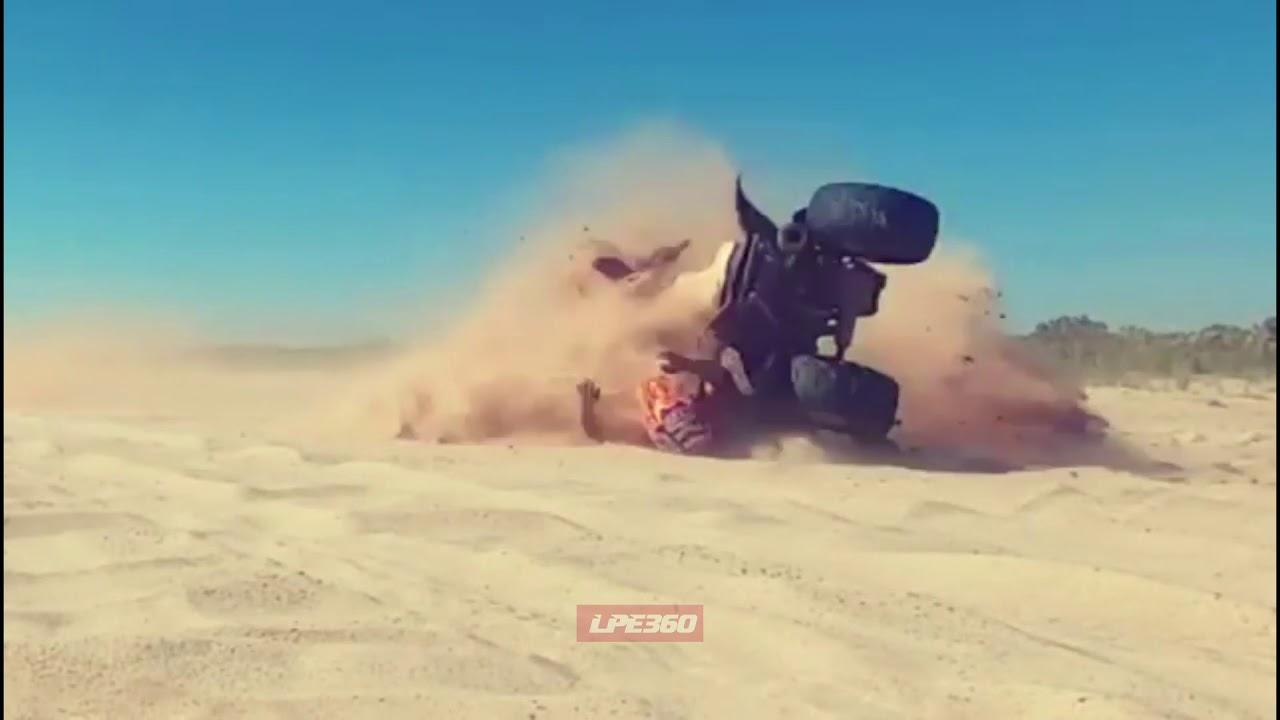 ATV rolls over into sand dune