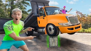 DESTROYING $1 MILLION UNBREAKABLE MONEY BOX with GIANT TOY TRUCK!!