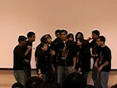 indian group singing a song from omshantiom
