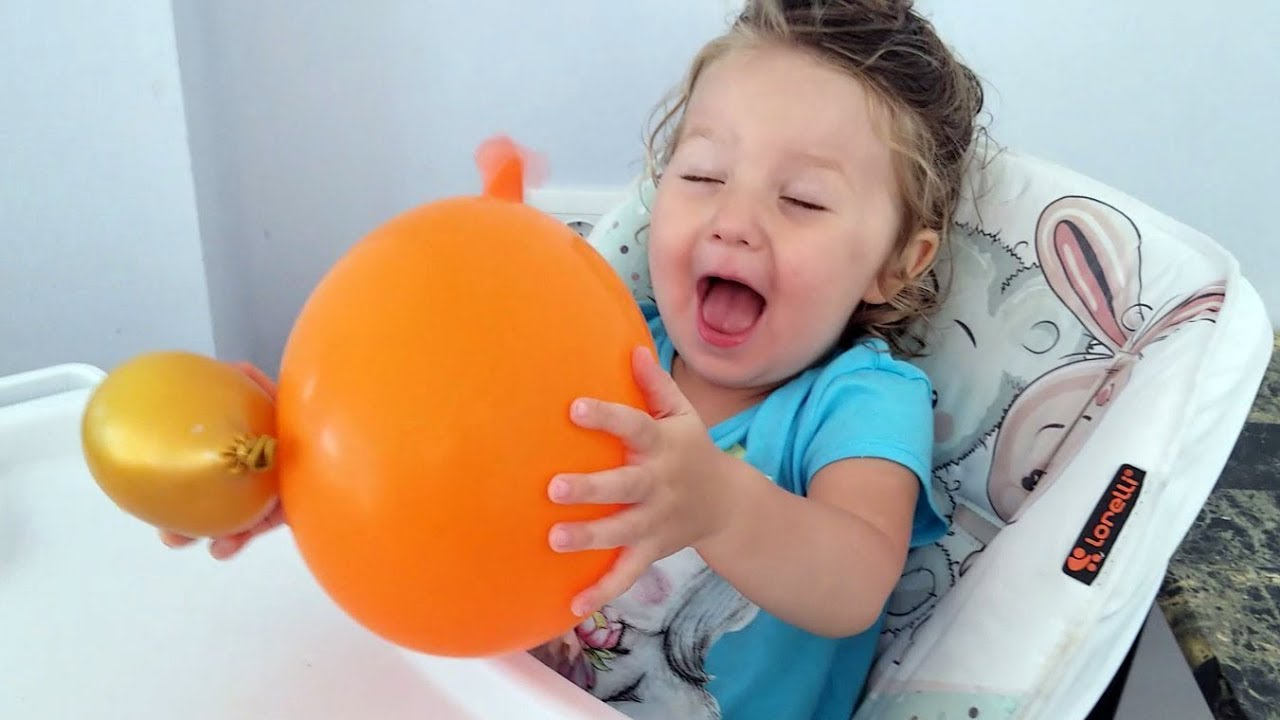 Cute Toddler with party Balloon for the first time - Cute Baby Lile
