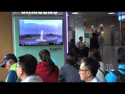 Thumbnail: Residents and tourists in S.Korea react to N.Korean missile test