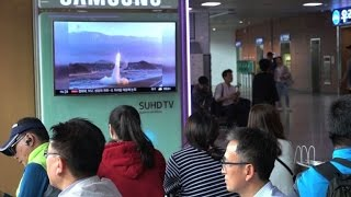 Residents and tourists in S.Korea react to N.Korean missile test