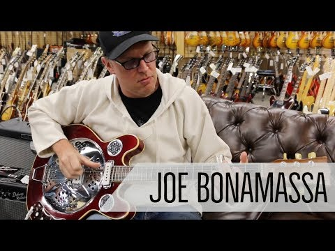 Norm presents Joe Bonamassa with a Vincent Bell Guitar at Norman's Rare Guitars