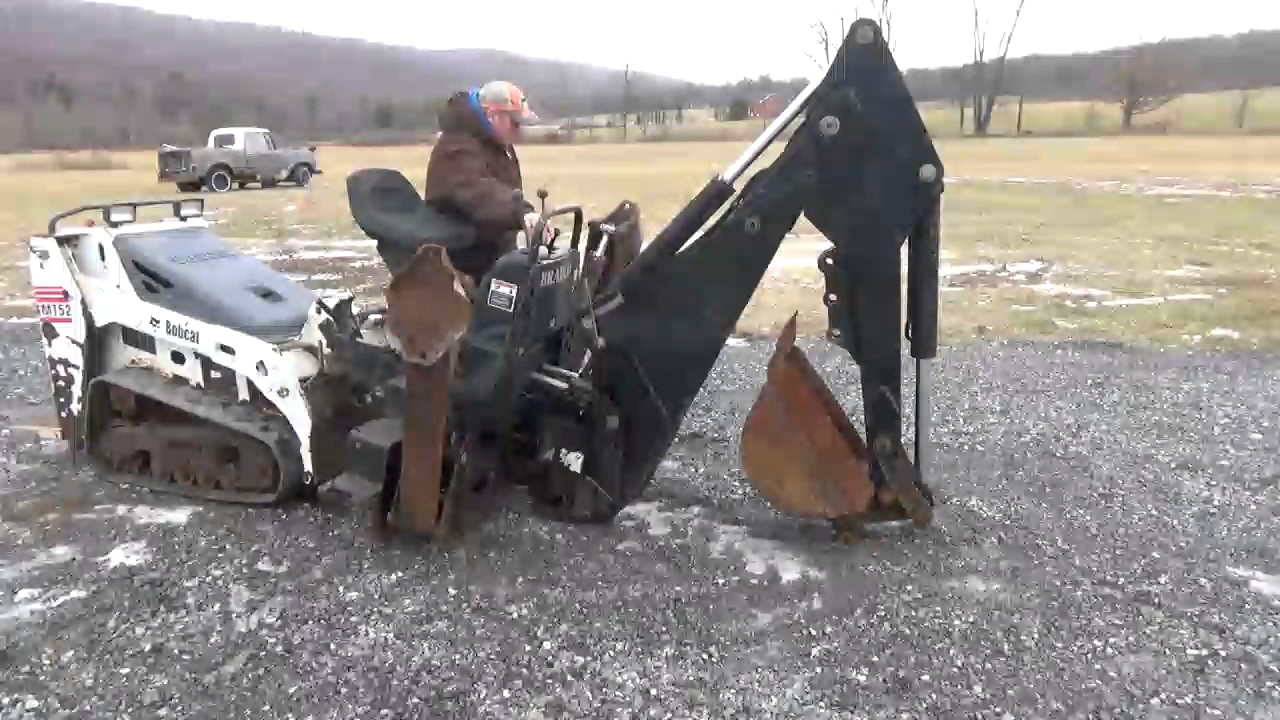 Bradco 609 Skid Steer Backhoe Attachment For A New Holland
