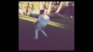 Justin beiber playing football with friend