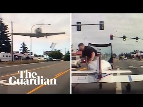 Plane's emergency landing captured on police dashboard camera