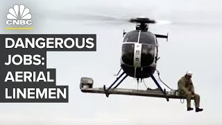 These Linemen Make Six Figures Dangling From Helicopters Video