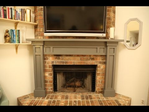 http://checkinginwithchelsea.com/video/build-a-diy-fireplace-mantel/ has all of the details you need to build this beautiful mantel over a brick fireplace! U...