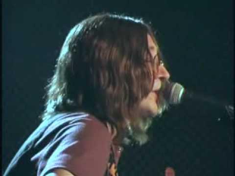 Mark Staycer as John Lennon