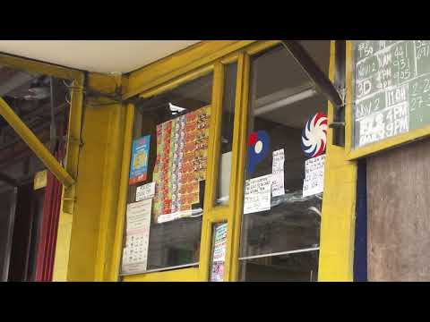 File footage - PCSO lotto outlet (España, Manila; 10-28-2014) HD