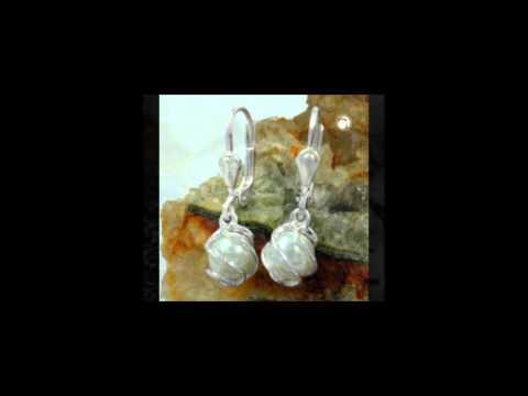 Pendants, studs and earrings in Silver 925