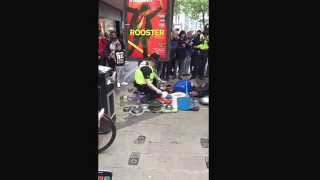 Police Officer plays the pots and pans in Birmingham City Centre