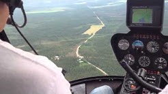 Helikopteri kyytiä säräisniemen yllä