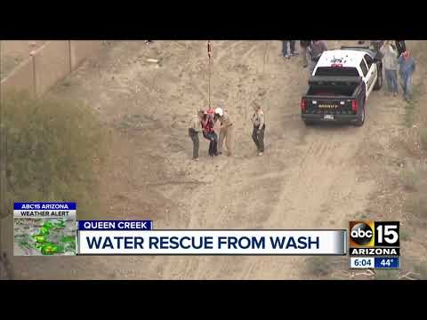 Two people clinging to branches rescued from Queen Creek wash in San Tan Valley