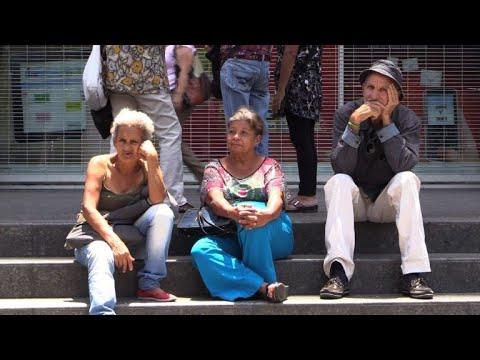 Venezuelans queue for monthly pension to buy half a kilo of meat