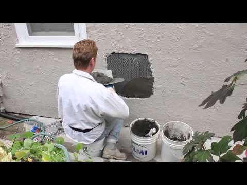 Repair a hole in a stucco wall caused by plumbing rendering repairs