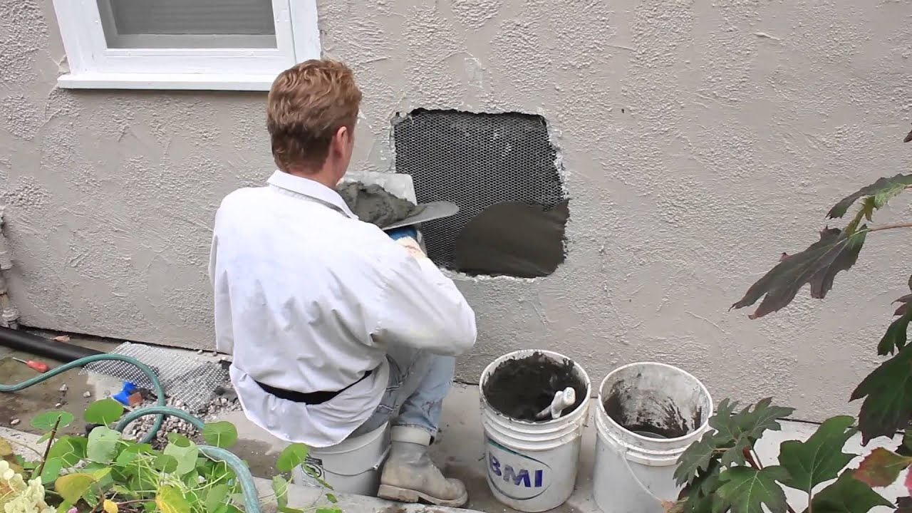 Repair a hole in a stucco wall caused by plumbing rendering ...