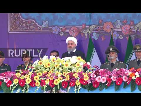 Iran: Defiant Rouhani showcases military might during Tehran parade