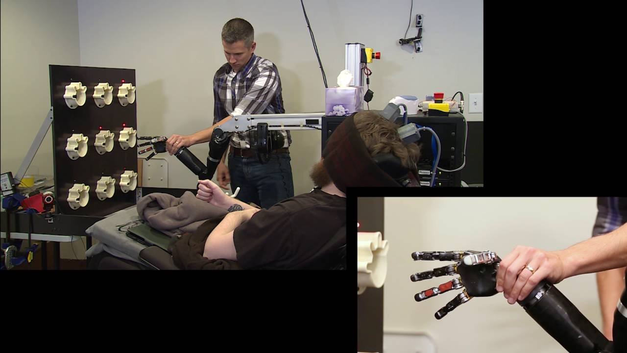 Mind-controlled robot arm gives back sense of touch to