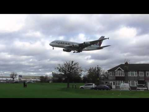 vid86 Qatar a380 over houses  Plane spotting Heathrow Heavies in strong wind   15nov15 1241p