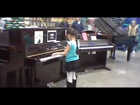 Young girl on a piano at Costco