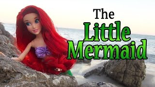 the little mermaid fairy tale with disney princess ariel and barbie dolls