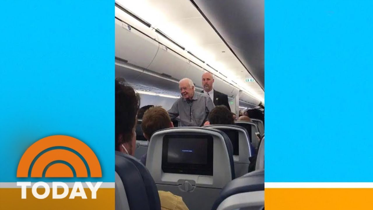 Video shows former President Jimmy Carter shaking hands with everyone on flight