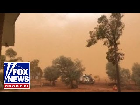 Dust storm covers Australia town in film of orange