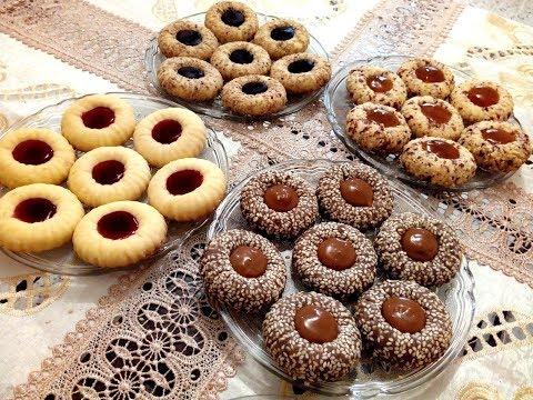 ام خولة حلويات جافة 4 اذواق بعجينة واحدة  بدون بيض وصفات العيد 2018 thumbnail