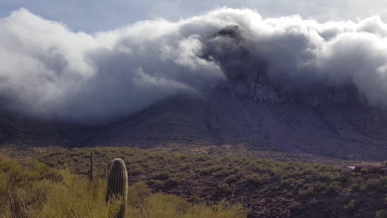 Clouds falling off Pusch Ridge