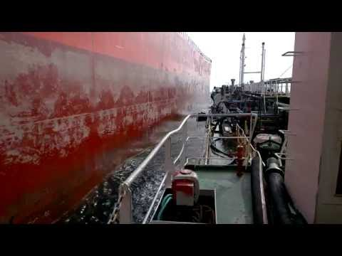 Bunkering at rough sea in Indian ocean.