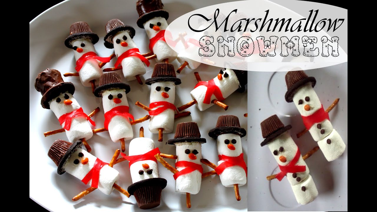 Marshmallow snowman winter treats and chocolate dipped pretzel
