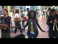 Jennifer Phillips singing in San Fran. Market and Powell Street
