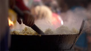 Closeup shot of a roadside Halwai preparing the stuffing for samosa - Indian food