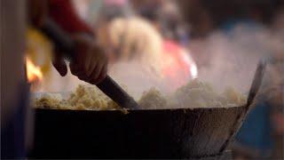 Closeup shot of a roadside Halwai preparing the stuffing for samosa - Indian food