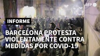 Manifestación contra restricciones por covid-19 degenera en disturbios en Barcelona | AFP
