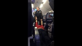 Woman dragged off Delta flight