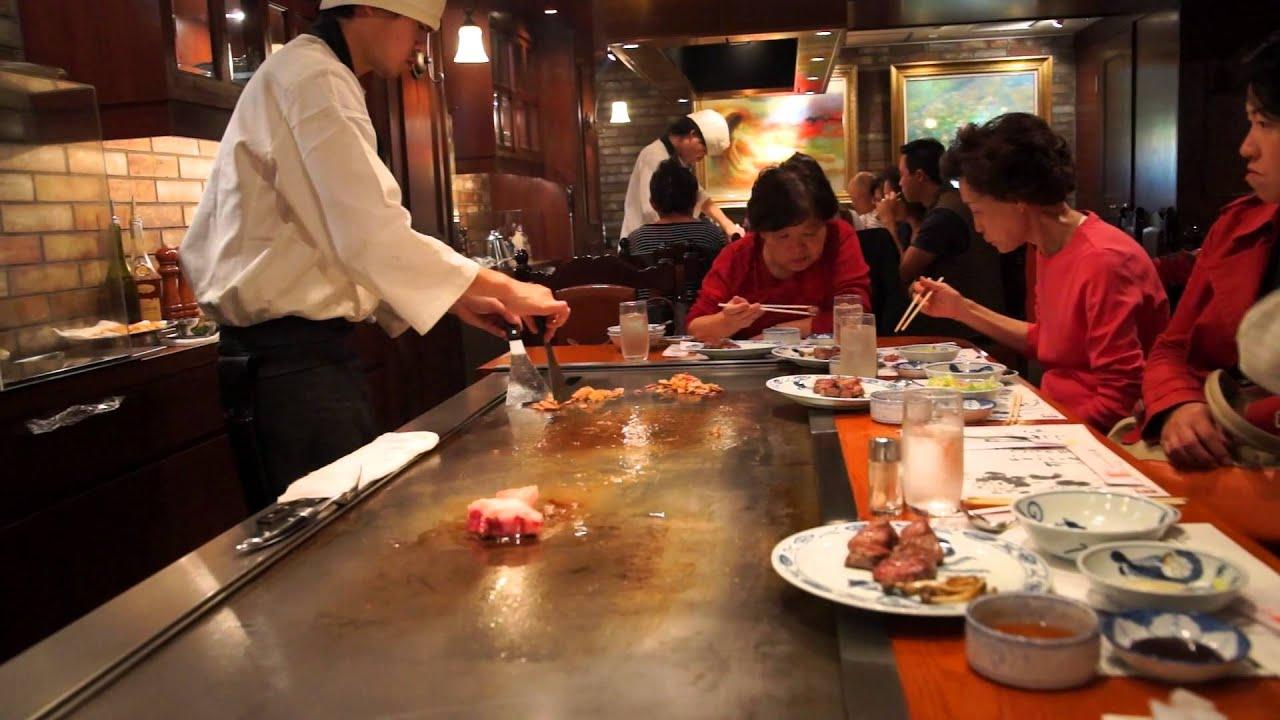 Japanese chef preparing Kobe beef steaks